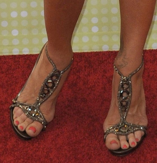 Denise Richards shows off her gorgeous feet in studded sandals