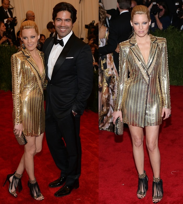 Elizabeth Banks posing with shoe designer Brian Atwood on the red carpet at the 2013 Met Gala held at the Metropolitan Museum of Art in New York City on May 6, 2013