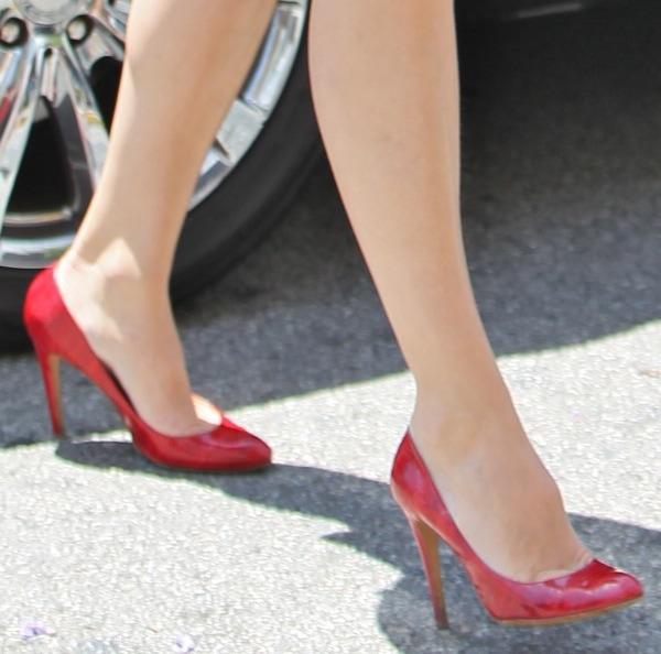 Emily Mortimer's bright red Saint Laurent pumps