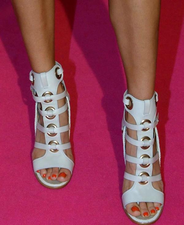 Erika Heynatz showing off her feet in gladiator sandals