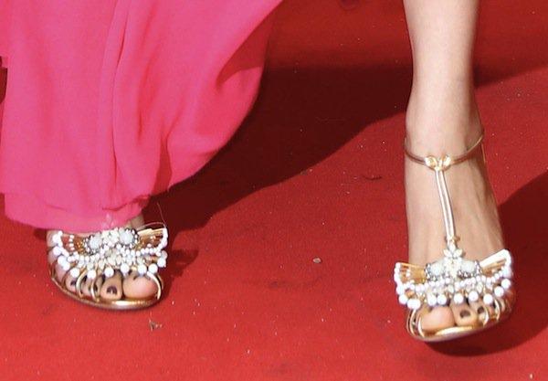 Freida Pinto'sgold embellished sandals