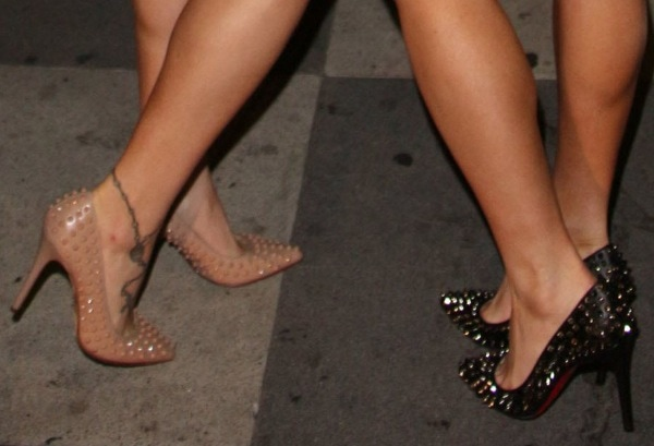 The Howe Twins showing off their feet in spike-studded pumps