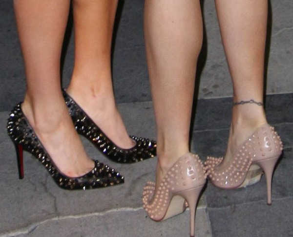 Carla and Melissa Howe showing off their feet in spike-studded pumps