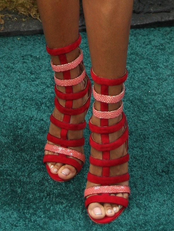 Jada Pinkett-Smith shows off her simple pedicure in red-and-pink strappy heels by Azzedine Alaia
