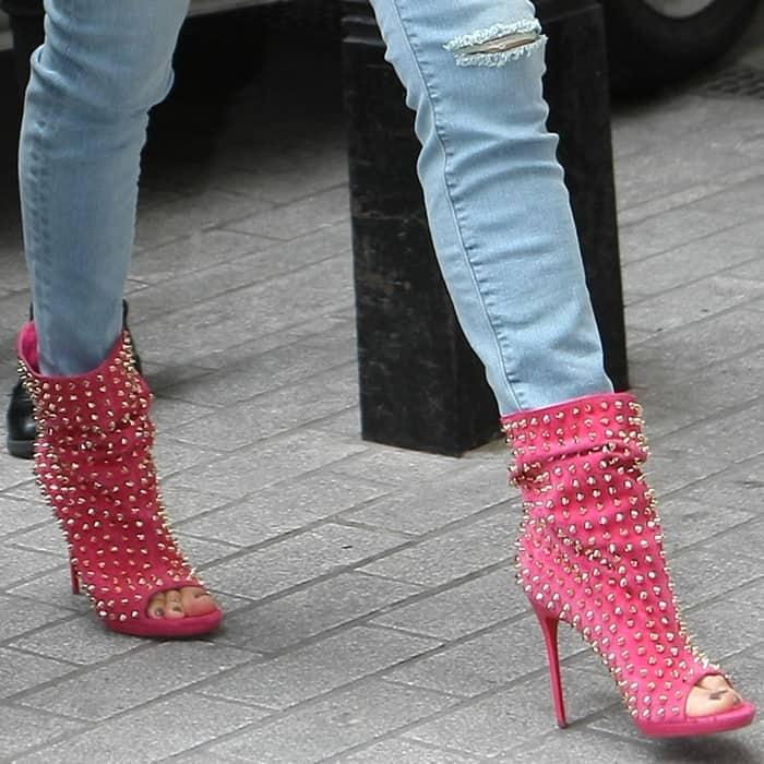 Jennifer Lopez wearing Christian Louboutin's Guerilla boots