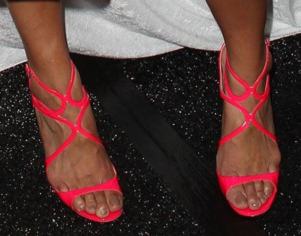 Jordin Sparks displays her pretty feet in neon Jimmy Choo sandals