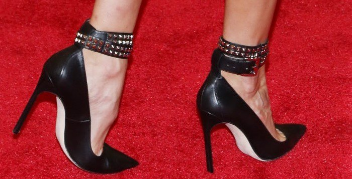 Karolina Kurkova shows off her feet in studded ankle-strap pumps