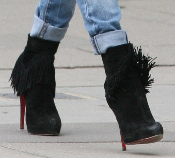 Kate Moss wearing Christian Louboutin Rom fringed suede ankle boots