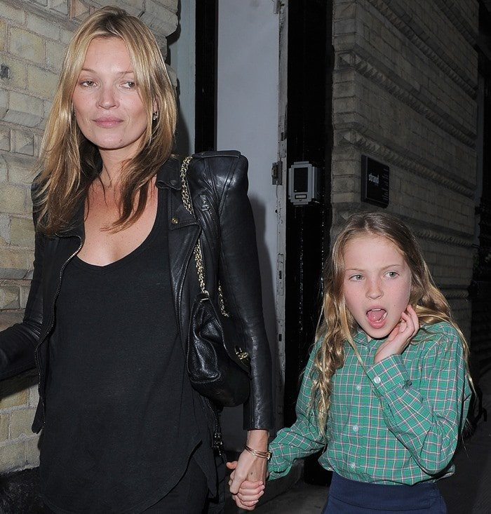Kate Moss and her daughter Lila Grace Moss attend an exhibition of fashion photographer Debbi Clark's portraits
