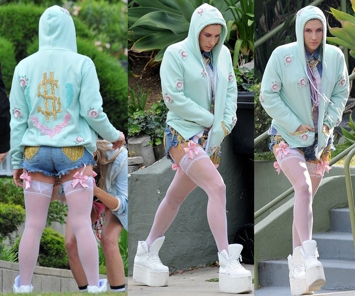 Pop star Ke$ha in high-top sneakers with white thigh-highs that connected with pink bow garters