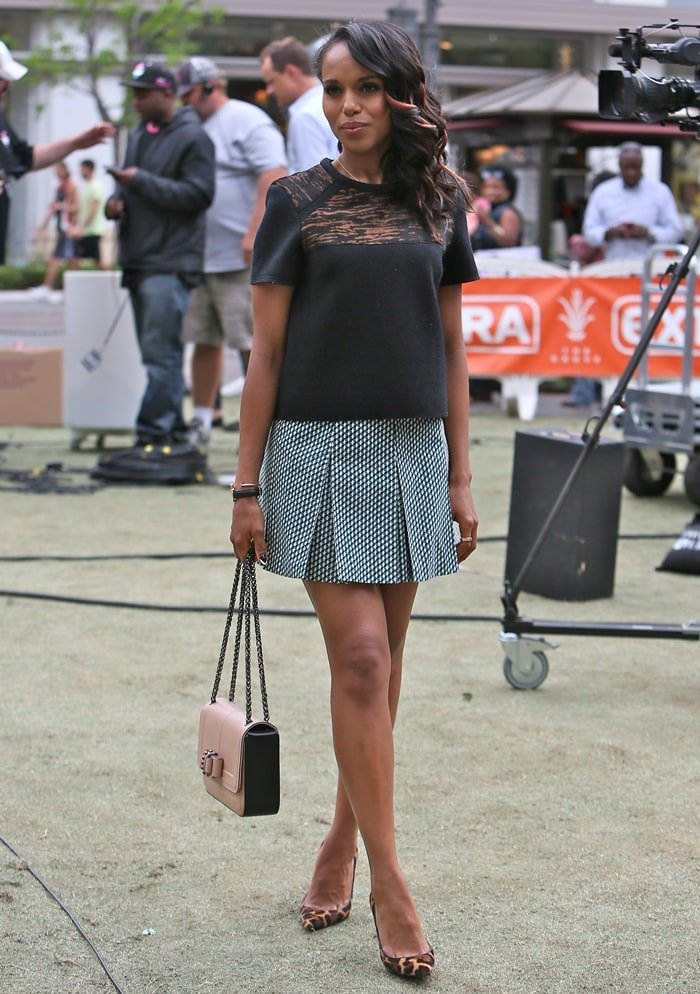 Kerry Washington finished the outfit with leopard-print pumps and a pale neutral bow-detailed 'Sotto Sweet Charity' shoulder purse from Christian Louboutin