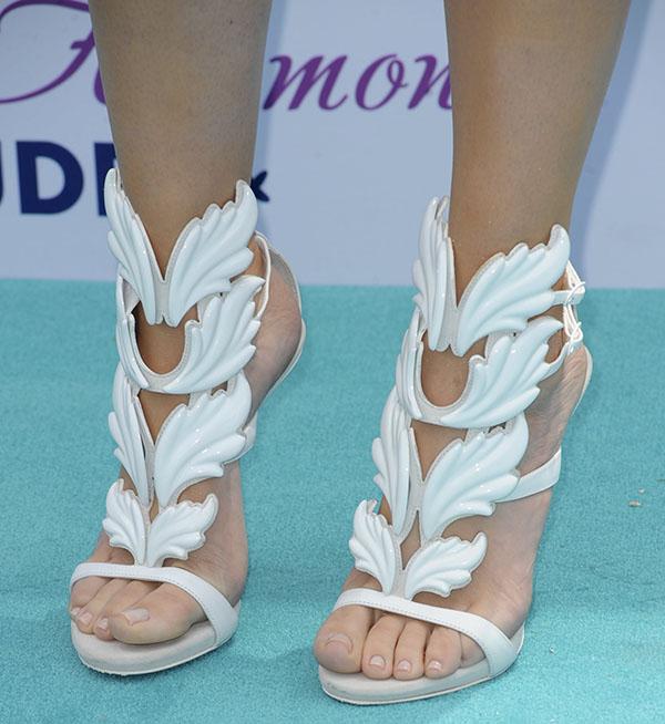 Khloe Kardashian Odom celebrates the launch of HPNOTIQ liqueur's Glam Louder program