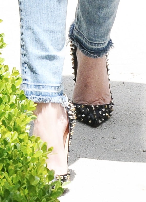 Khloe Kardashian in black studded pumps by none other than Christian Louboutin