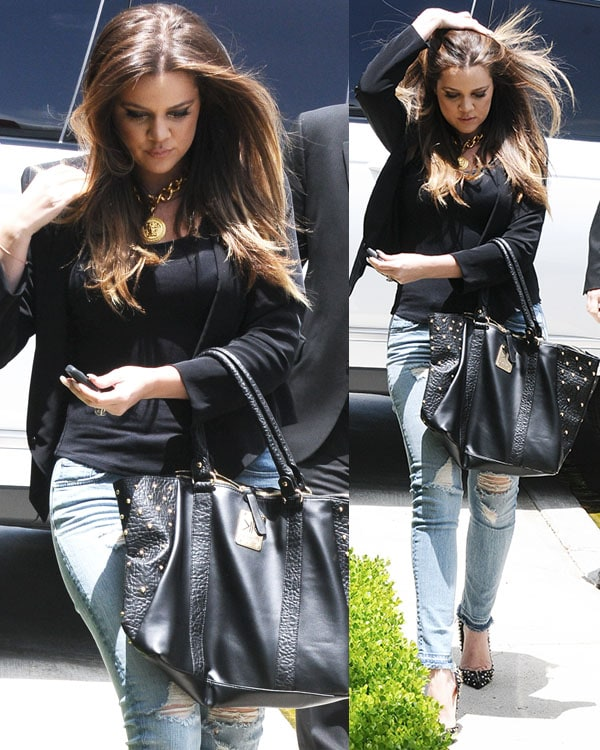 Khloe Kardashian looked absolutely gorgeous in her black top and blazer