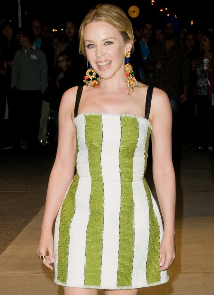 Kylie Minogue wearing a dress in bright green and white stripes