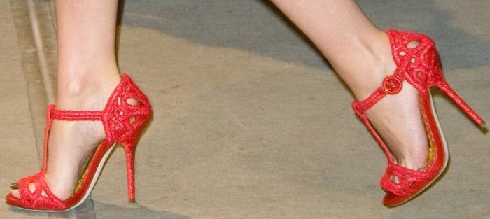 Kylie Minogue wearing strappy red Dolce & Gabbana sandals