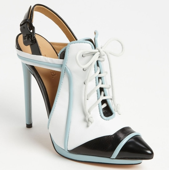 An arresting lace-up vamp fronts a daring, menswear-inspired pump