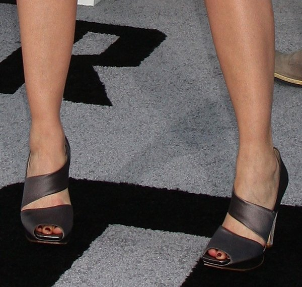 Lea Thompson shows off her hot feet in asymmetrical satin heels