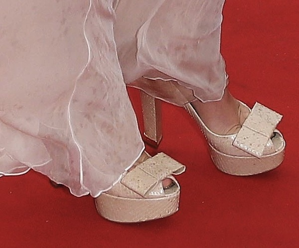 Ludivine Stagnier inshimmery peep-toe pumps with large bows