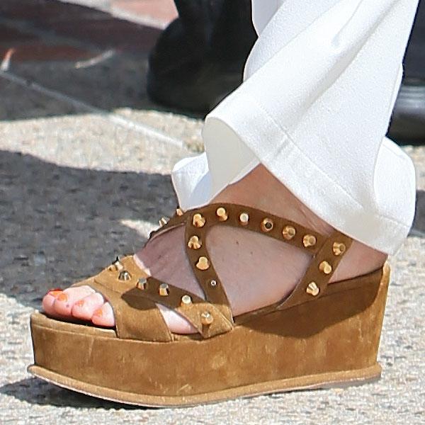 Minnie Driver wearing studded suede flatforms
