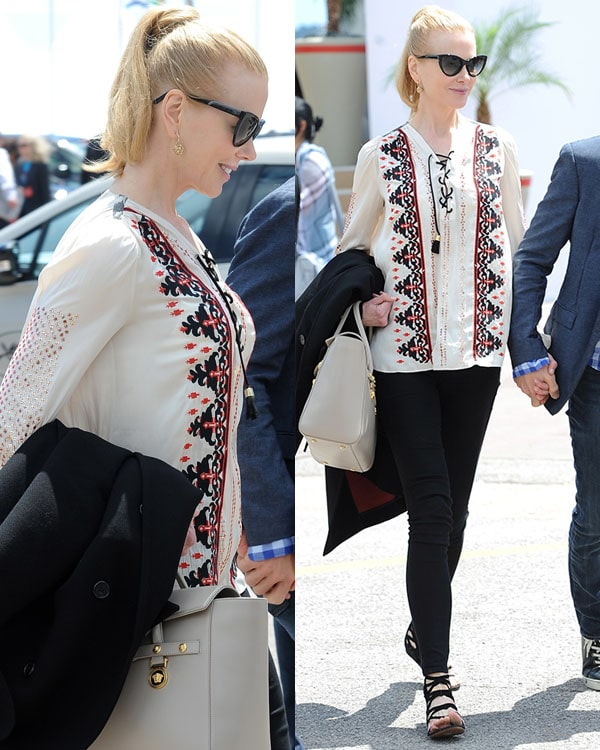 Nicole Kidman wearingan elegant embroidered top paired with black pants