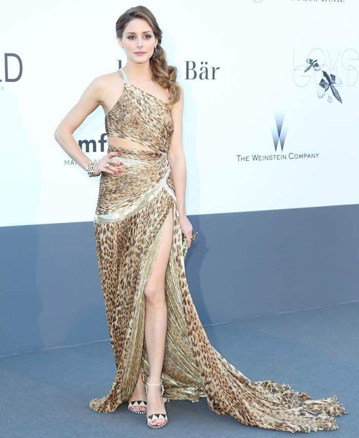 Olivia Palermo wearing a one-shouldered, belly-baring, and slit-up-to-there leopard-print dress by Roberto Cavalli