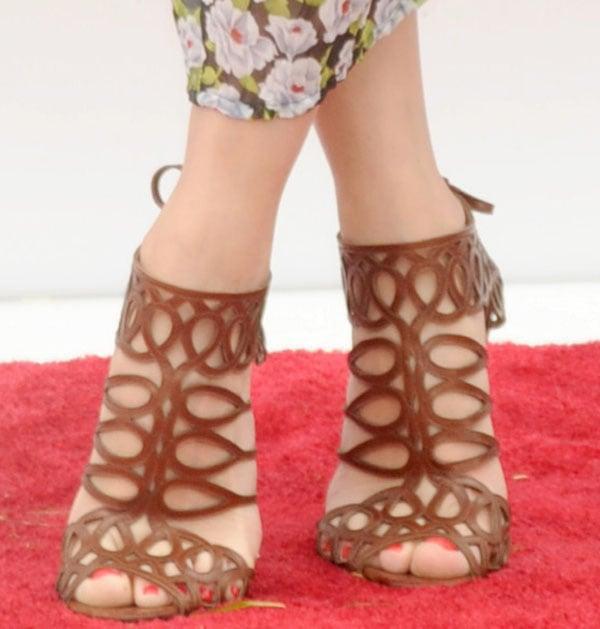 Olivia Palermo wearing Christian Louboutin Zigouwi sandals