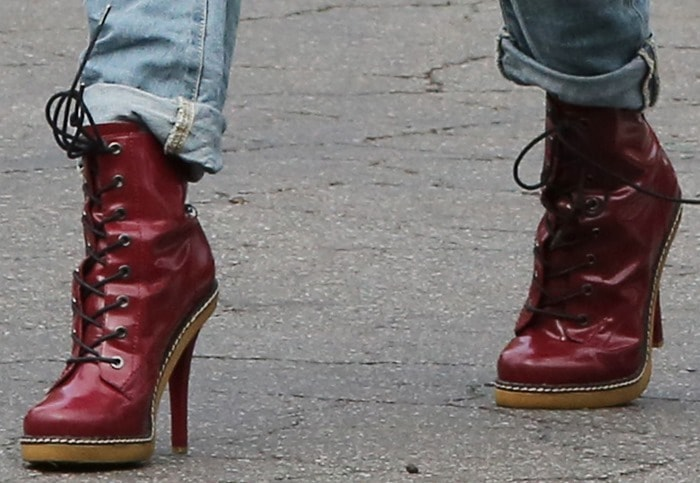 Oxblood stiletto boots livening up Gwen Stefani's grungy outfit