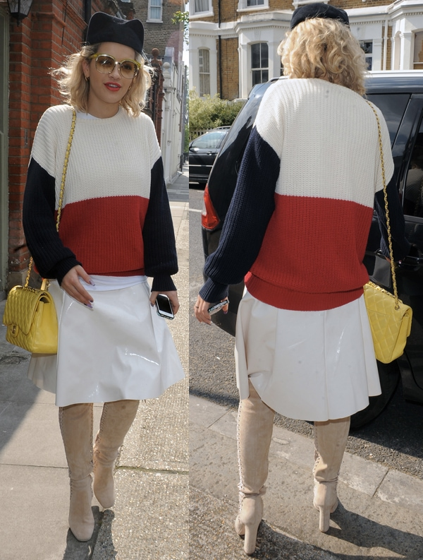 Rita Ora wearing a tri-color knitted sweater with a plastic-looking skirt