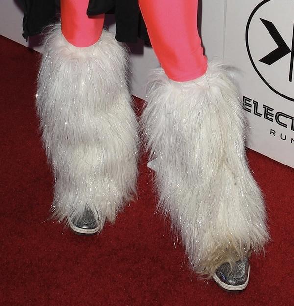Vanessa Hudgens in fur calf covers and metallic silver Nike sneakers