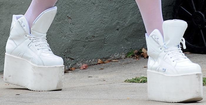 Pop star Ke$ha wearing white high-top sneakers