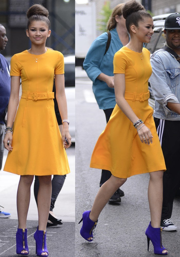 Zendaya wears a marigold-hued belted dress while out in Manhattan