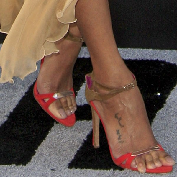 Zoe Saldana's Oscar Tiye shoes feature bright red suede insoles