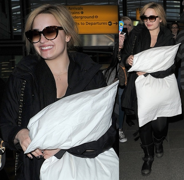 Demi Lovato clutching a large pillow