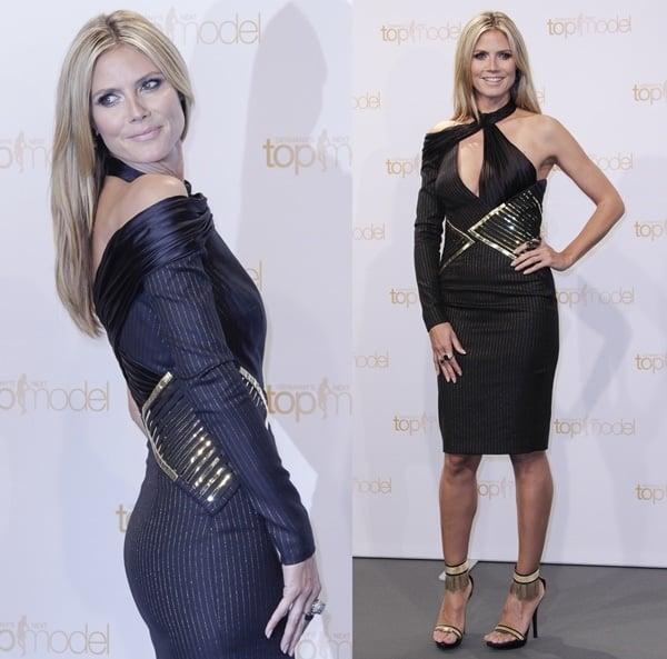 Heidi Klum'sblack dress with a triangular gold waist belt