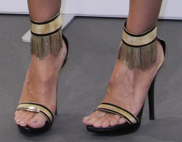 Heidi Klum in Versace sandals featuring ankle straps with striking fringed chain embellishments in gold