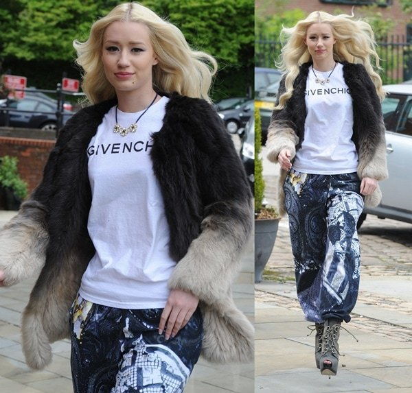 Iggy Azalea inan ombre fur jacket, a white tee, and another pair of printed sweatpants