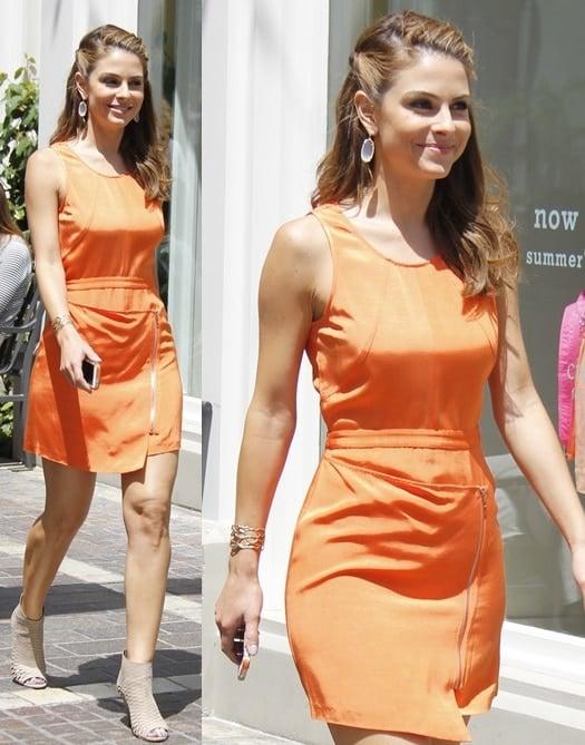 Maria Menounos wearing a bright orange mini dress while heading to the set of Extra