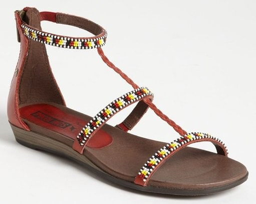 A comfort-minded sandal is designed and hand-beaded by female members of the