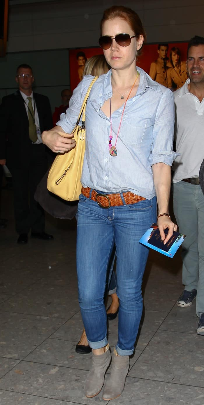 Amy Adams with the cast of 'Man of Steel' at Heathrow Airport in London on June 12, 2013<