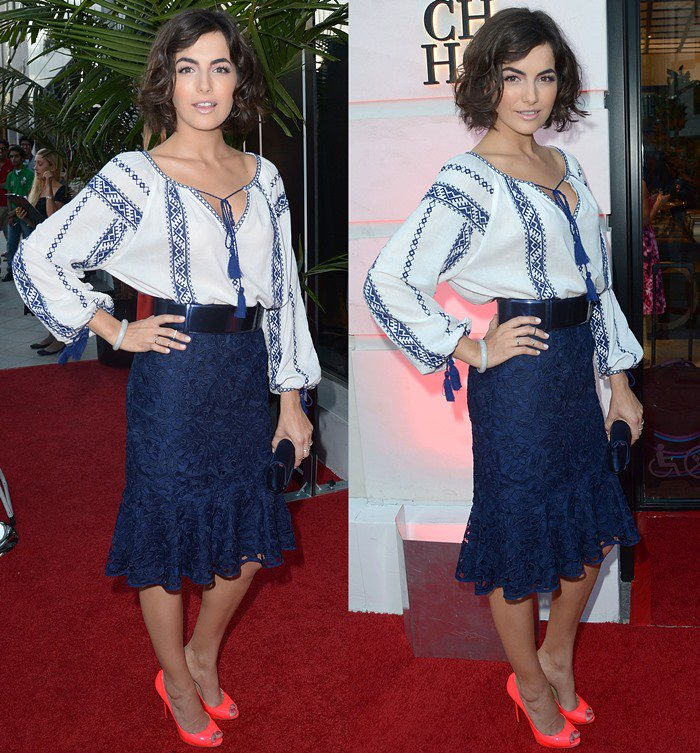 Camilla Belle pairs neon pumps with a navy blue look