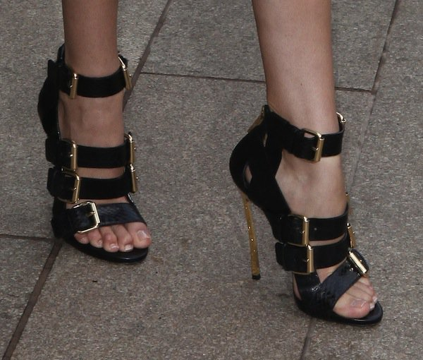 Candice Swanepoelshows off her sexy feet in buckled sandals