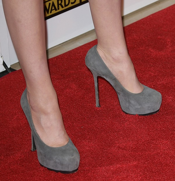 Carly Chaikin's classic pumps feature sky-high platforms and thin heels