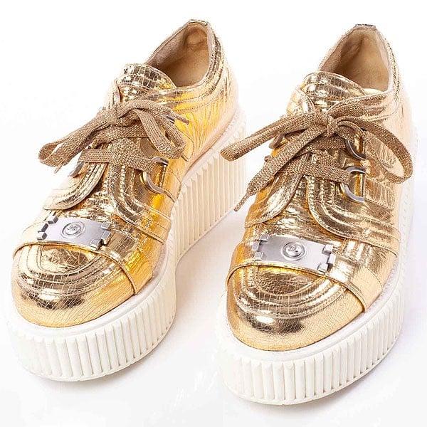 10c1c74e8de Rihanna Exudes Swag in Metallic Gold Chanel Creepers