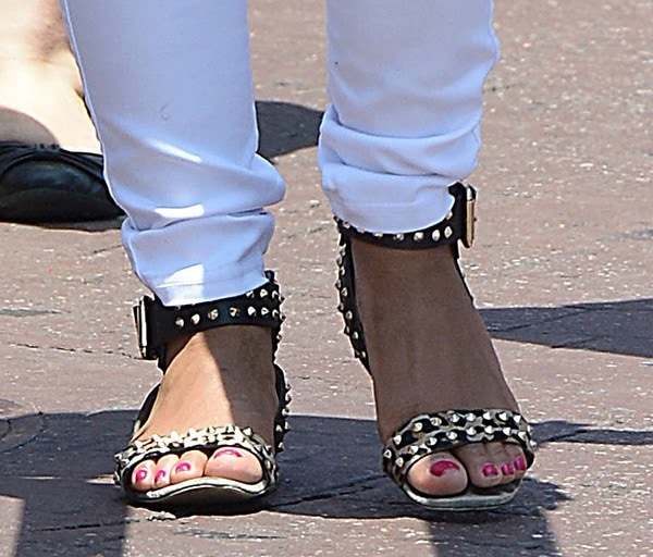Christina Milian shows off her fuschia pedicure in a pair of gold studded sandals from Zara