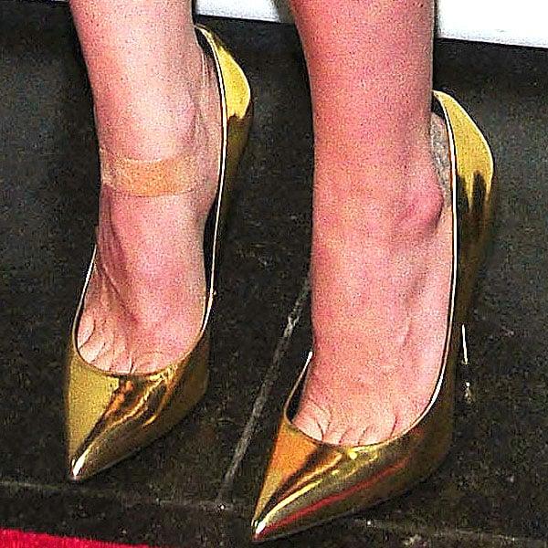 Christina Ricci's super shiny gold pumps up close