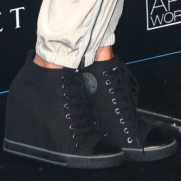 7cdf5b0d6929 Celebrity Guests Mix Sporty and Trendy Shoes at DKNY Artworks Launch