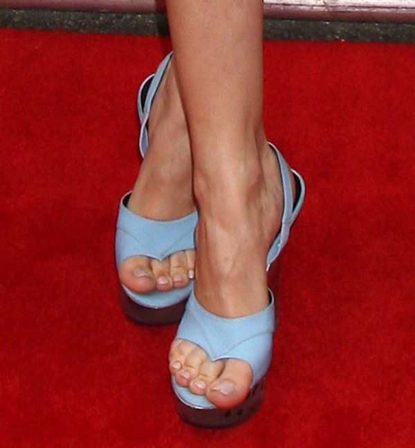 Debby Ryan's sexy feet in very unique blue wedges