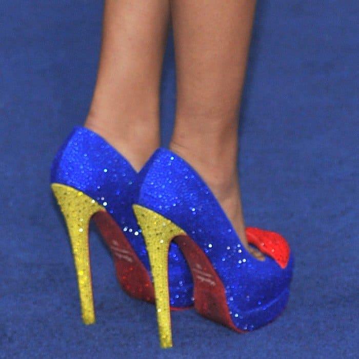 Dionne wearing bright Kandee high heels