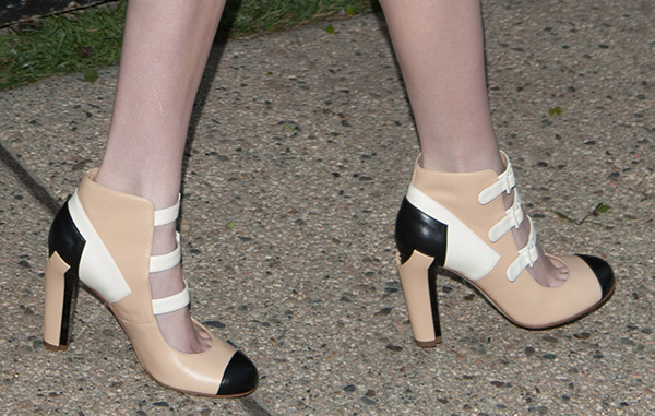 Emma Roberts wears a pair of Chanel heels to a Chanel-hosted event